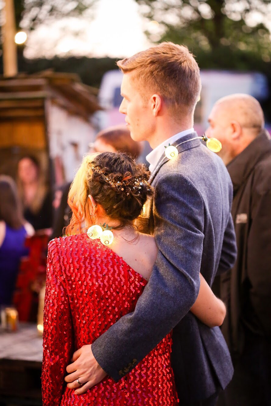 matt and emina from behind in an embrace