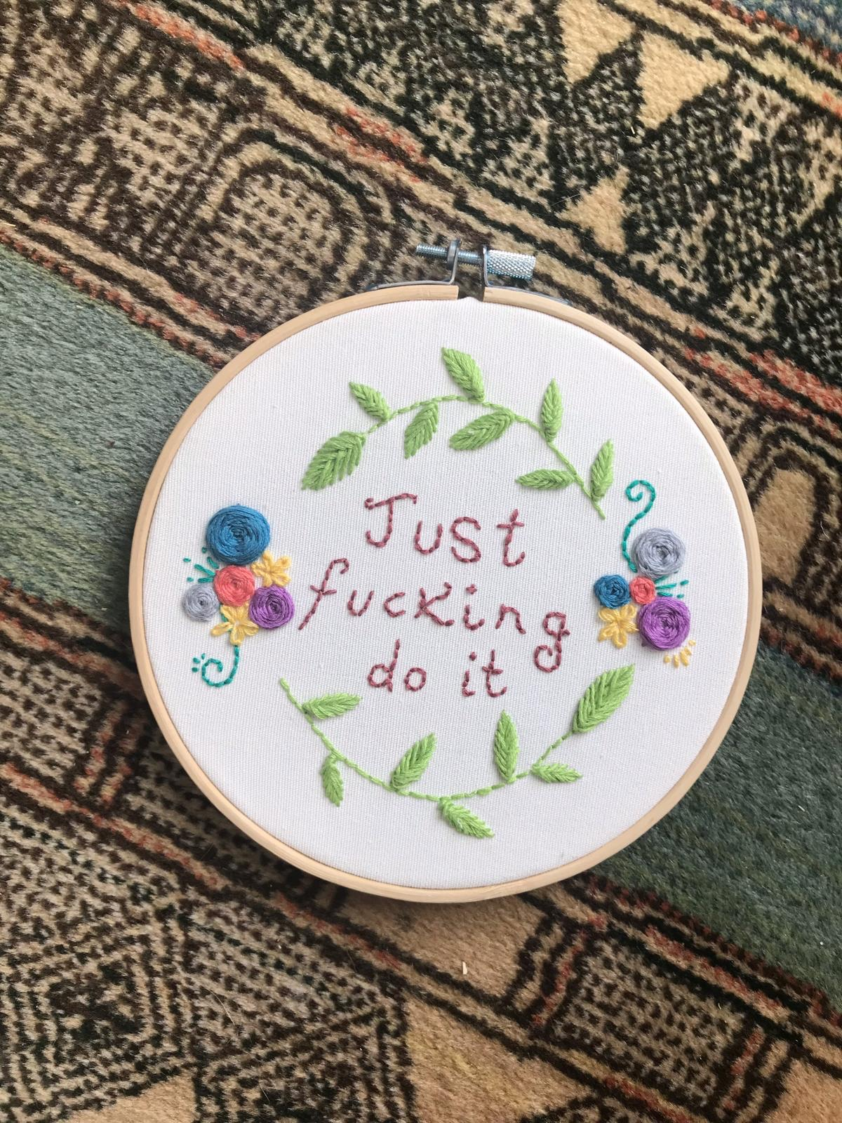embroidered circle saying just fucking do it