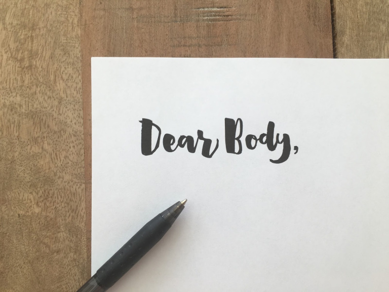 note pad with the words Dear Body written on